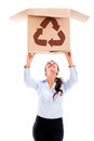 Woman lifting a recyclable box Royalty Free Stock Images