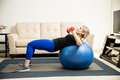 Woman lifting weights and using stability ball Royalty Free Stock Photo