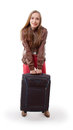 Woman lifts a heavy suitcase isolated on white background Royalty Free Stock Images