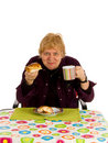 Woman liking her breakfast Royalty Free Stock Images