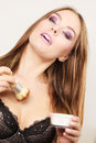 Woman in lingerie applying loose powder with brush Royalty Free Stock Photo