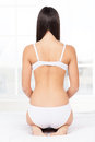 Woman in lingerie rear view of young kneeling on the bed Royalty Free Stock Photography