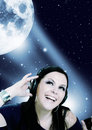 Woman listening music in the moon light Royalty Free Stock Image