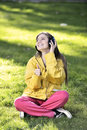 Woman listening to music female student girl outside in park on headphones while studying happy young Royalty Free Stock Photography