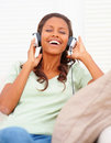Woman listening to music on the headphones Royalty Free Stock Image
