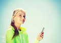 Woman listening to music outdoors sport and lifestyle concept doing sports and Royalty Free Stock Photo