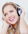 Woman listening to music over headphones Stock Photo