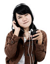 Woman listening to music with the phone and having fun isolated on white background Stock Images