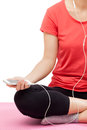 Woman listening to music for relaxing and sitting on exercise mat isolated on white background Royalty Free Stock Images
