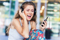 Woman listening to music young Stock Photography