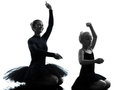 Woman and little girl ballerina ballet dancer dancing silhouett in silhouette on white background Royalty Free Stock Images