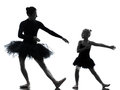 Woman and little girl ballerina ballet dancer dancing silhouett in silhouette on white background Stock Image