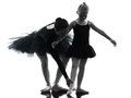 Woman and little girl ballerina ballet dancer dancing silhouett in silhouette on white background Royalty Free Stock Image