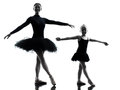 Woman and little girl ballerina ballet dancer dancing silhouett in silhouette on white background Royalty Free Stock Photos