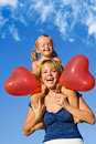 Woman with little girl and balloons Royalty Free Stock Photo