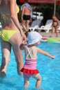 Woman and little girl going on paddling pool Royalty Free Stock Photography