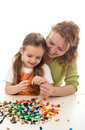 Woman and little girl playing with beads Royalty Free Stock Image
