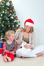 Woman and little girl playing with cat at christmas Royalty Free Stock Image