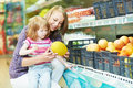 Woman and little girl shopping Stock Photo