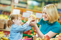 Woman and little girl shopping Stock Photos