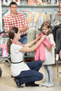 Woman and little girl shopping clothes Stock Image