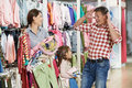 Woman and little girl shopping clothes Royalty Free Stock Image