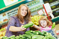 Woman and little girl shopping fruits Royalty Free Stock Photo