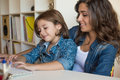 Woman and little girl using computer Royalty Free Stock Photo