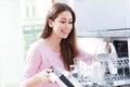 Woman loading dishwasher Royalty Free Stock Photo
