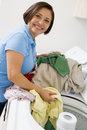 Woman Loading Washing Machine Stock Photography