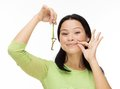 Woman locked mouth with key on white asian keep isolated Royalty Free Stock Image