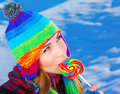Woman with lollipop outdoors Stock Image