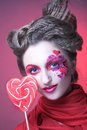 Woman with lollipop young lady artistic visage and Stock Photos