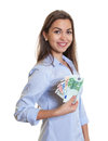 Woman with long brown hair saves money on an isolated white background for cut out Stock Photography