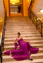 Woman in a long dress lying on the stairs Royalty Free Stock Images