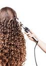 Woman with long hair, hand barber curling irons on white. Royalty Free Stock Photo