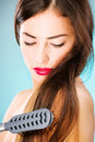 Woman with long hair holding comb pretty and Stock Photos