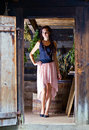 Woman with long hair in old wooden building young beautiful Stock Photo