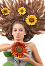 Woman with long hairs and sunflower Royalty Free Stock Photo