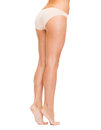 Woman with long legs in cotton underwear health and beauty concept Stock Photos