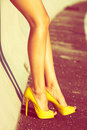 Woman long legs tan in high heel yellow shoes outdoor shot summer day Royalty Free Stock Photo
