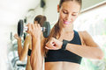 Woman look at her smart watch for heart beat rate showing a of excercising in gym Royalty Free Stock Image