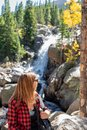 Woman looking at Alberta Falls in Rocky Mountain National Park Royalty Free Stock Photo