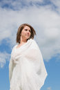 Woman looking away against blue sky and clouds low angle view of young Stock Photography