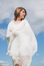 Woman looking away against blue sky and clouds low angle view of young Royalty Free Stock Photos
