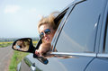 Woman looking back out of a car window Royalty Free Stock Images