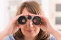 Woman looking through binocular beautiful at home Stock Image