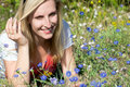 Woman looking at blue flowers Royalty Free Stock Photo