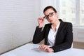 Woman looking disdainfully lifting eye glasses Royalty Free Stock Photo