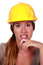 Woman looking disgusted wearing helmet Royalty Free Stock Photography